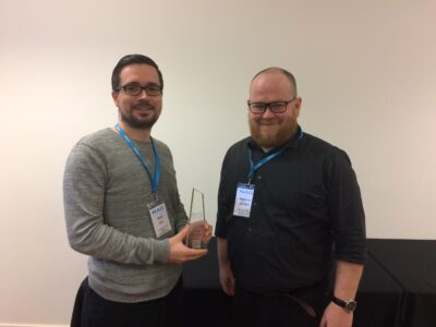 Matt Cox receiving NAG award trophy from Anthony Sinnott (NAG Exec)